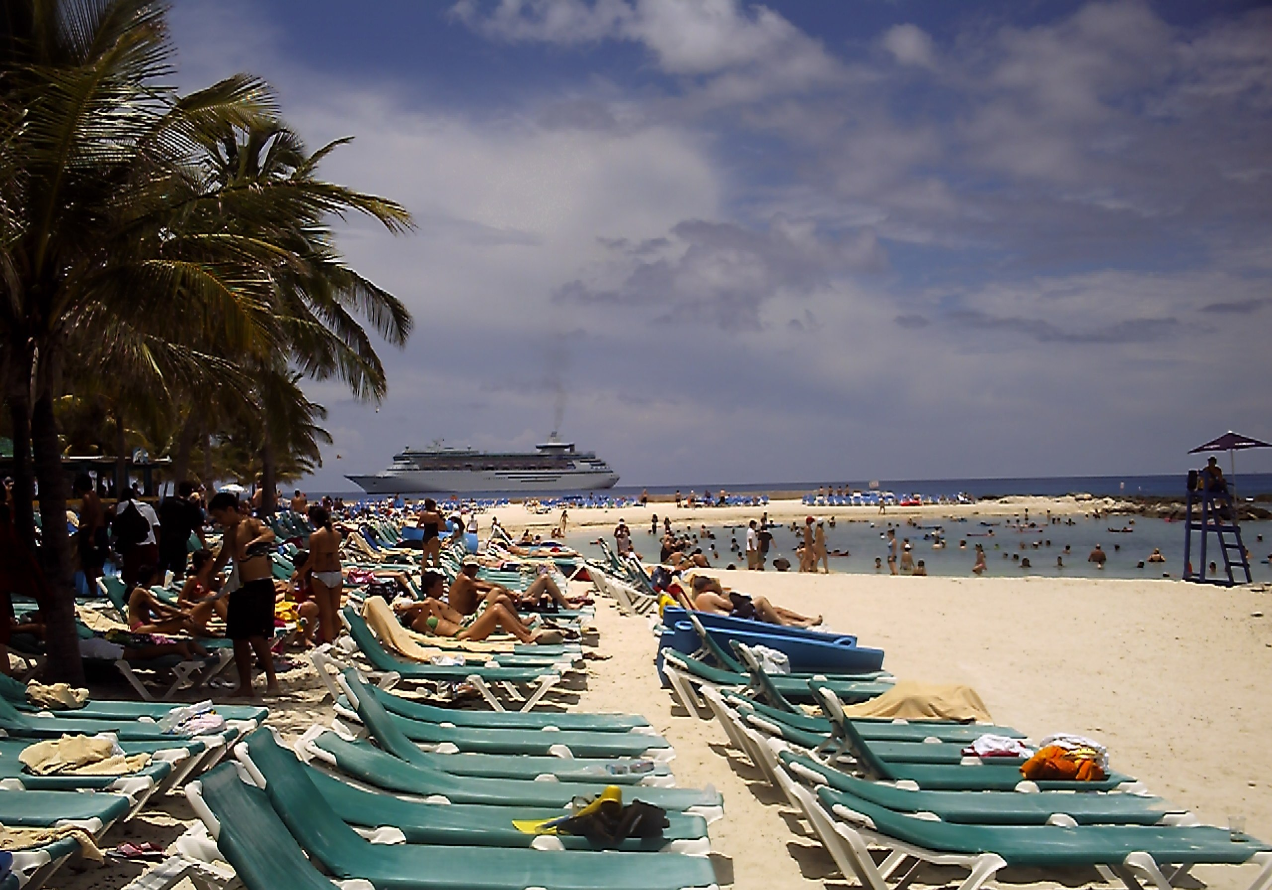 This is the beach on Coco Cay with the cruise ship docked in the distance.