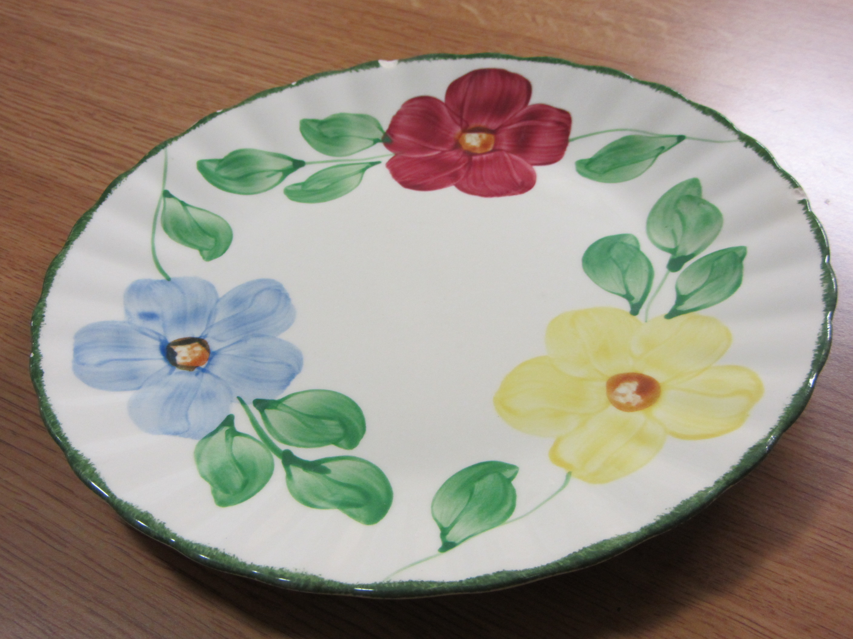 I didn't take a picture of a plate for the 18th, but I took this one on the 21st for this prompt. This is one of a few hand-painted plates that belonged to my paternal grandmother.