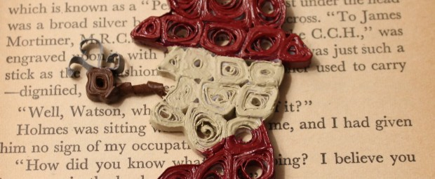Quilled and acrylic painted Sherlock Holmes posed on the first page of The Hound of the Baskervilles.